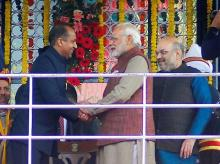 Prime Minister Narendra Modi greets the newly sworn-in Chief Minister of Himachal Pradesh, Jairam Thakur as BJP President Amit Shah looks on, after the oath ceremony at Ridge in Shimla Photo: PTI