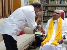 Superstar Rajinikanth meeting with DMK chief M Karunanidhi at Karunanidhi's residence. Photo: PTI