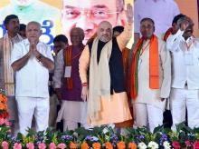BJP President Amit Shah, state BJP chief B S Yeddyurappa along other state leaders during Parivartan Yatra, in Chitradurga near Bengaluru. Photo: PTI
