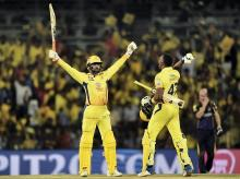 Chennai Super Kings (CSK) batsmen Ravindra Jadeja and Dwayne Bravo celebrate after beating KKR by 5 wickets during an IPL 2018 cricket match against KKR at MAC Stadium in Chennai. Photo: PTI