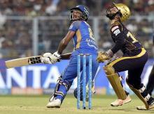 KKR vs RR, IPL 2018, Rajsthan Royals' batsman Sanju Samson plays a shot as KKR's captain wicketkeeper Dinesh Karthik looks on during the 2nd qualifier IPL eliminator cricket match between KKR and Rajasthan Royals at Eden Garden in Kolkata. Photo: PTI