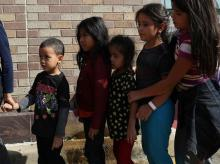 Children form a line as undocumented immigrant families are released from detention at a bus depot in McAllen, Texas. Photo: Reuters
