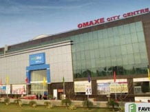 Will not pledge Omaxe shares except in ...