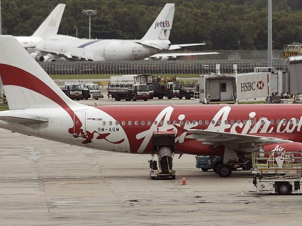 An AirAsia plane is parked on the tarmac at the Changi International Airport