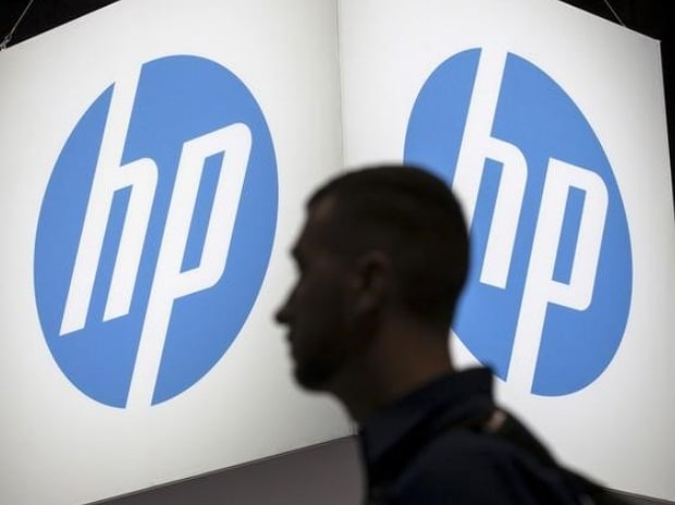 An attendee at the Microsoft Ignite technology conference walks past the Hewlett-Packard (HP) logo in Chicago, Illinois