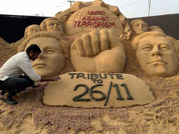 Sand sculptor Sudarshan Patnaik making memorial for paying tribute to Mumbai terror attack 2008 victims