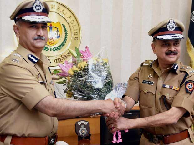 Outgoing Mumbai Police Commissioner Javed Ahmed (R) greets his succeeder Dattatray Padsalgikar in Mumbai on Sunday PTI