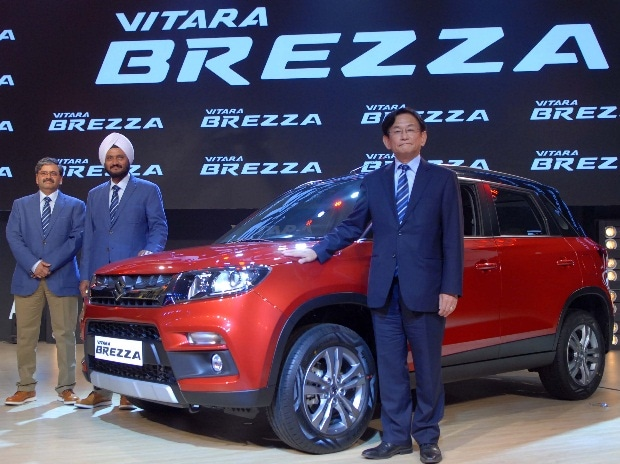 (From left to right) C V Raman, Executive Director, Engineering, R S Kalsi, Executive Director, Sales and Marketing and Kenichi Ayukawa, MD & CEO, Maruti Suzuki at the launch of Vitara Brezza in Mumbai