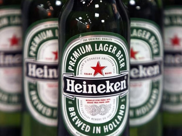 Bottles of Heineken beer are displayed before a news conference in London. Photo: Reuters