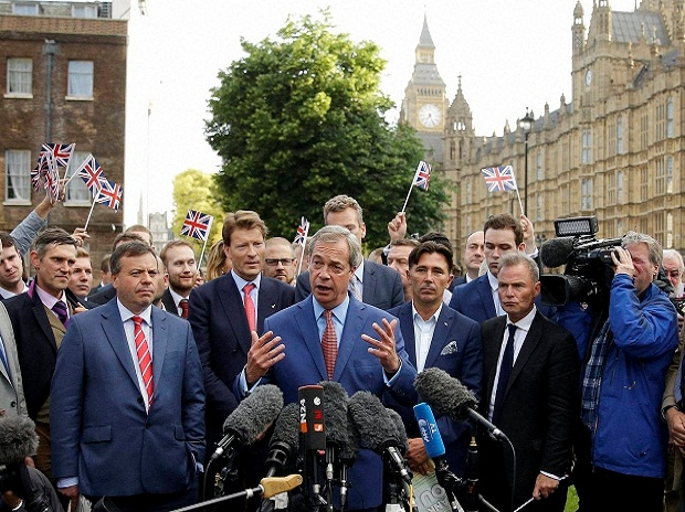 Nigel Farage, the leader of the UK Independence Party speaks to the media on College Green with the Houses of Parliament in the background in London.