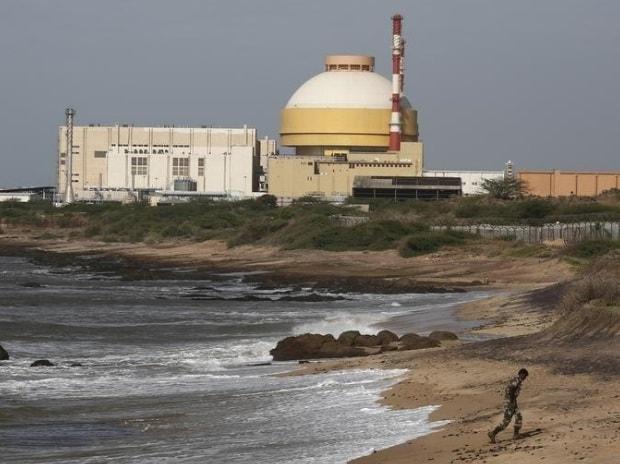 A policeman walks on a beach near Kudankulam nuclear power project (photo: Reuters)