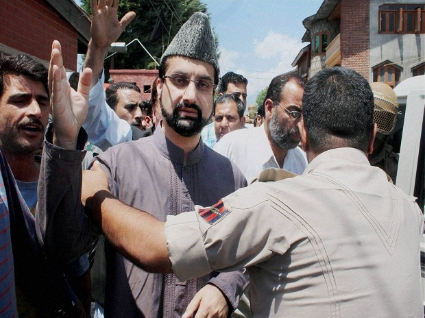 Police arrests Chairman of Moderate faction of Hurriyat Conference Mirwaiz Umar Farooq after he defied his house detention and led a protest march towards Jamia Masjid at Nigeen in Srinagar on Friday Photo: PTI