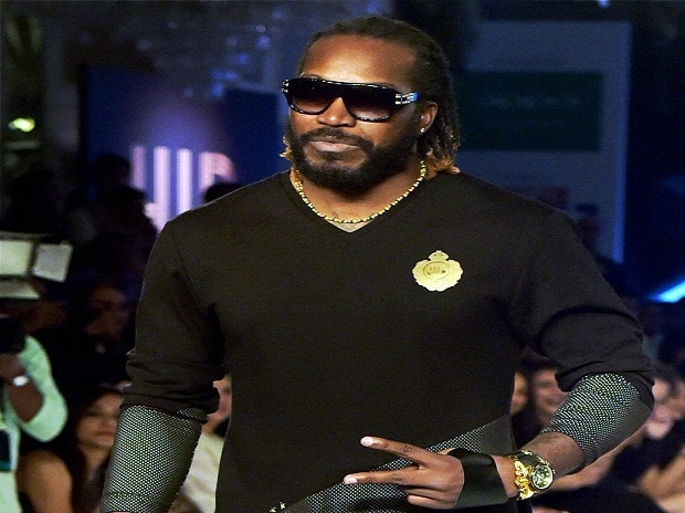 West Indies cricketer Chris Gayle displays Yuvraj's fashion label YWC at its launch in Mumbai.