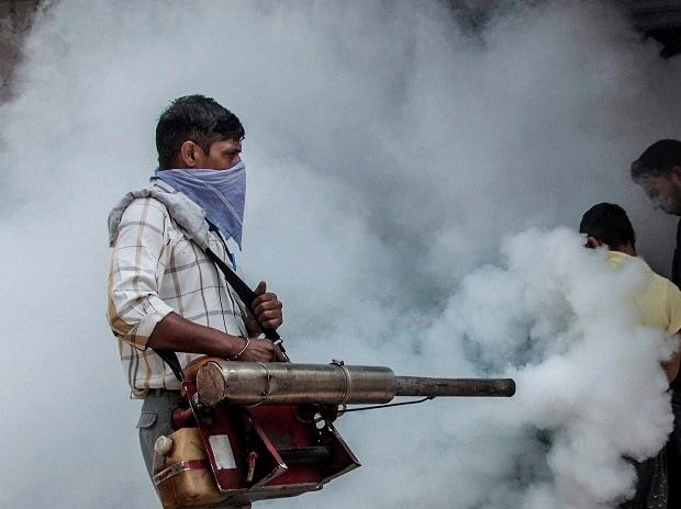 A Municipal Corporation of Delhi (MCD) employee fumigates near Hindu Rao Hospital in New Delhi. Photo: PTI