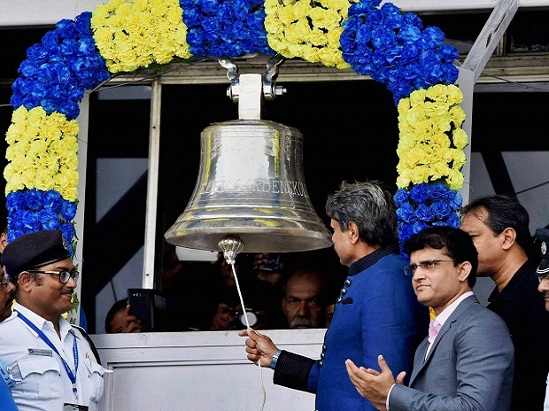 Former Indian Cricketer Kapil Dev rings the bell as CAB President Sourav Ganguly looks on to start the first day match of 2nd Test match between India and New Zealand at Eden Gardens in Kolkata.