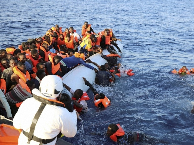 Migrants on a rubber dinghy are rescued by the vessel Responder in the Mediterranean sea