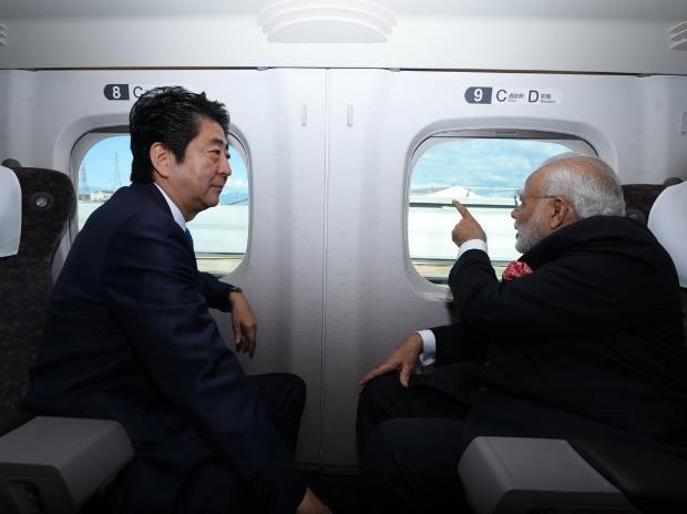 Indian PM Narendra Modi (right) with Japan's PM Shinzo Abe (left) travelling in the Shinkansen bullet train (Photo: @MEAIndia Twitter handle)