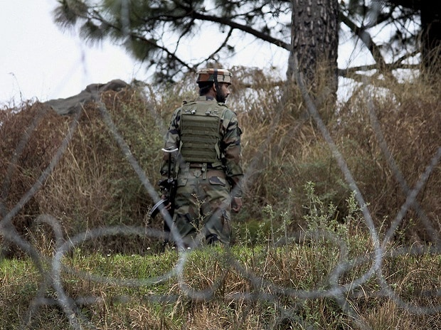 An Indian Army jawan patrolling at the Line of Control in Poonch district of Jammu and Kashmir, days after ceasefire violations by the Pakistan Army in Krishna Ghati sector. Photo: PTI