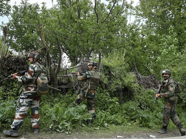Indian Army personnel standing guard during a crackdown at a village in Shopian district in South Kashmir. Photo: PTI