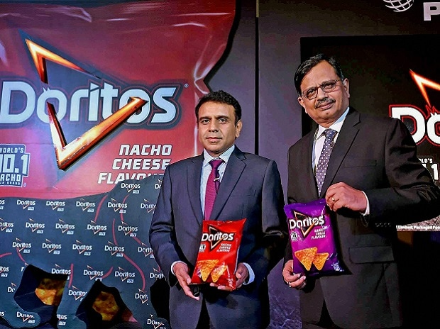 Jagrut Kotecha (L),VP-Snacks and Niteen Pradhan(R),VP Supply Chain and Operations, PepsiCo India pose at an event in Kolkata, Doritos