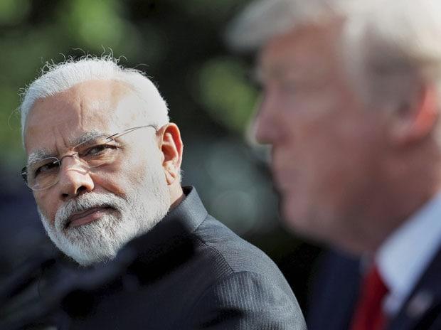 Prime Minister Narendra Modi looks toward US President Donald Trump as he speaks in the Rose Garden at the White House