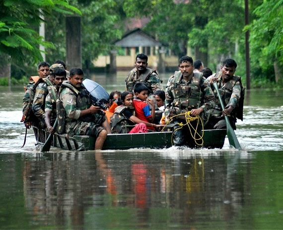 Nagaon: Army soldiers rescuing people from the flood affected village Debasatra at Jokhalabandha in Nagaon district of Assam on Sunday. PTI Photo
