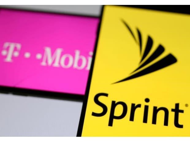 File photo of smartphones with the logos of T-Mobile and Sprint. (Photo: Reuters)