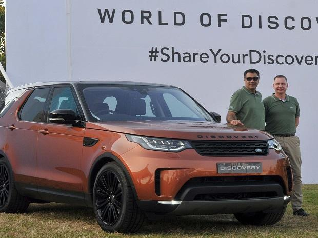 Rohit Suri, MD and president of Jaguar Land Rover India, and Mark Turner, brand director, JLR, overseas, during the launch of the new Land Rover Discovery in Mumbai on Saturday. The fifth-generation vehicle is priced at ~71.38 lakh to ~82 lakh