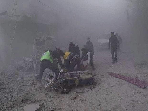 Douma  : In this photo provided by the Syrian Civil Defense group in Damascus suburbs known as the White Helmets, Civil Defense workers carry an injured man after government airstrikes hit Douma, near Damascus, Syria. (Photo: AP/PTI)