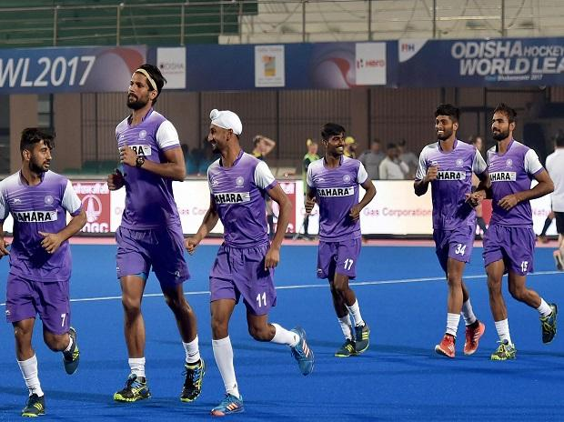 Bhubaneswar: Indian Hockey players  warm up during a training session on the eve of their match against Australia at Men's Hockey World League Final at Kalinga Hockey Stadium in Bhubaneswar
