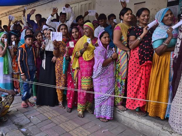 Woman voters wait in a long queue to cast their votes for the second phase of assembly elections at Raipur, Ahmedabad. Photo: PTI