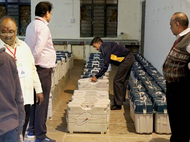 Election officers arrange the EVM machines inside the strong room on the day of state assembly election result, in Ahmedabad. Photo: PTI