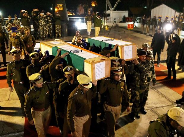 Senior CRPF  officers carrying the coffin after wreath laying ceremony, who were killed  in a Fidayeen (Suicide) attack at Lethpora Pulwama CRPF training centre,  at Humahama in the outskirts of Srinagar. Photo: PTI