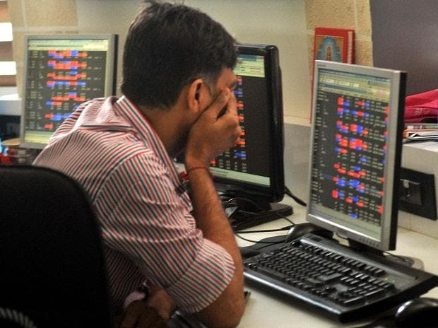 Stock brokers reacts as they watch the share prices of BSE sensex in Mumbai. Photo: Kamlesh Pednekar