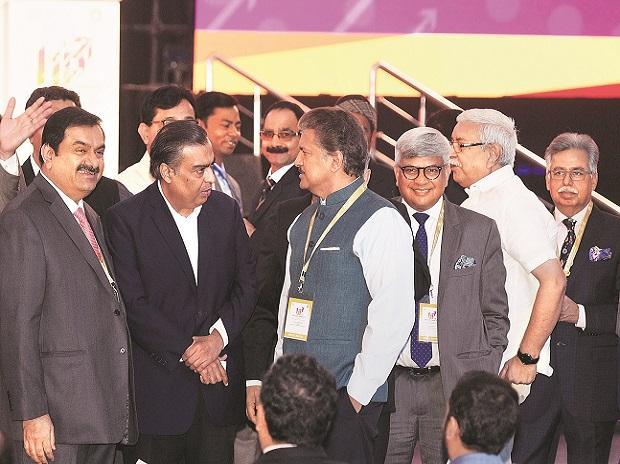 Industrialists Gautam Adani, Mukesh Ambani and Anand Mahindra attend the UP Investors' Summit 2018 at Indira Gandhi Pratishthan in Lucknow on Wednesday. Photo: PTI