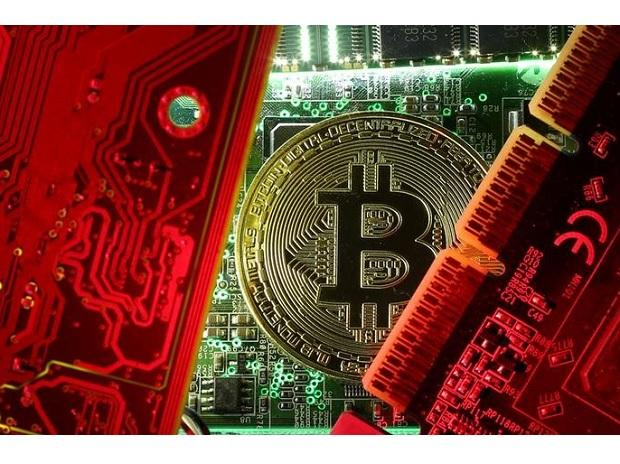 A copy of bitcoin standing on PC motherboard is seen in this illustration picture. (Photo: Reuters)