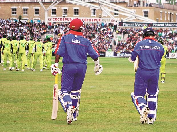 Brian Lara and Sachin Tendulkar stride out to bat for the International XI against Pakistan in an earthquake relief fund charity match in 2006. This columnist's World XI, however, has space only for Lara. Photo: Reuters