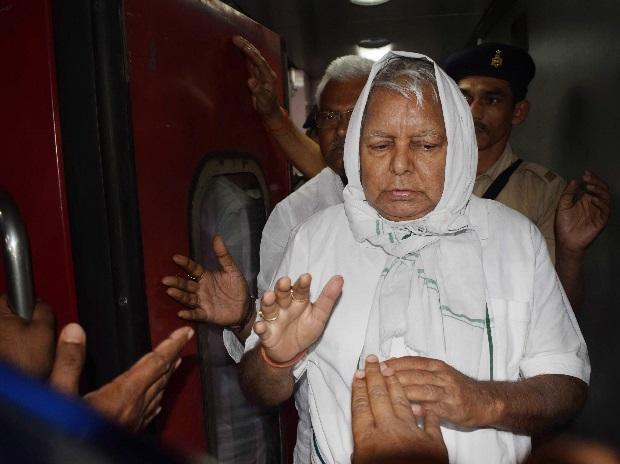 ormer Bihar Chief Minister and RJD Supremo Lalu Prasad Yadav arrives at Gaya Railway Station in Gaya. (Photo: PTI)