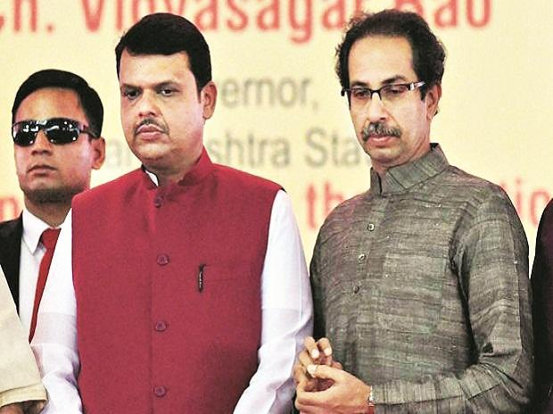 Shiv Sena chief Uddhav Thackeray (right) has dared Chief Minister Devendra Fadnavis (left) by challenging the BJP in the Palghar Lok Sabha bypoll Photo: PTI