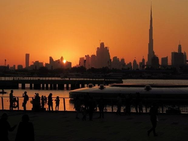 People watch the sunset in Dubai, United Arab Emirates. (Photo: Reuters)