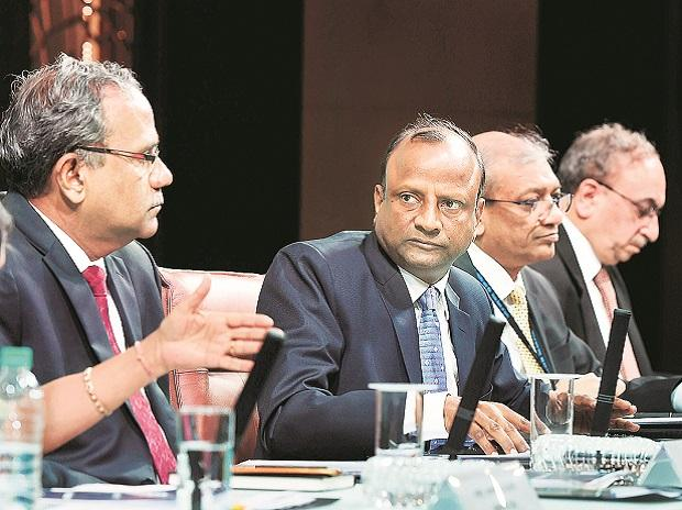 SBI Chairman Rajnish Kumar (second from left) during the announcement of the March quarter results, in Mumbai, on Tuesday. Photo: PTI