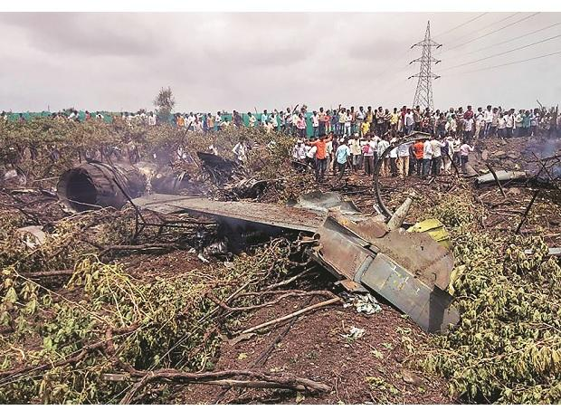 People gather near the debris of a Su-30 MKI fighter jet after it crashed at  Wavi-Tushi village near Nashik last Wednesday.  The accident will result in the largest aviation payout since Chennai floods of December 2015