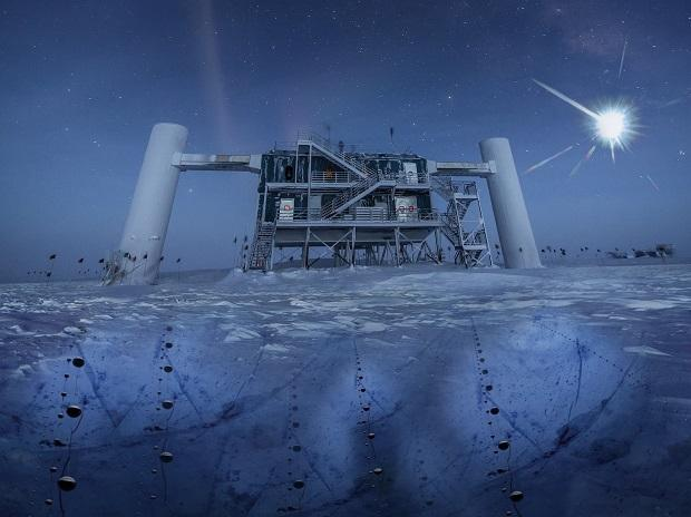 In this artistic composition, based on a real image of the IceCube Lab at the South Pole, a distant source emits neutrinos that are detected below the ice by IceCube sensors, called DOMs