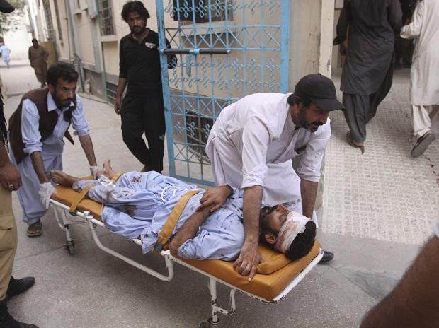 People rush an injured person to a hospital in Quetta, Pakistan. Photo: PTI