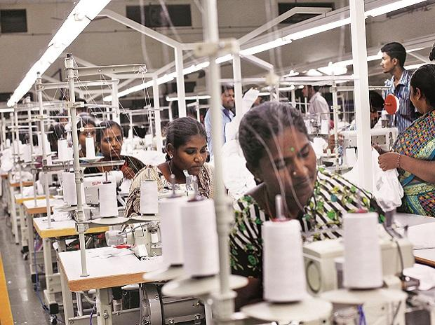 Sewn up: Employees sew clothes at the Estee garment factory in Tirupur, in  Tamil Nadu. Relatively high labour cost is costing the textile town its competitive advantage. Photo: Reuters