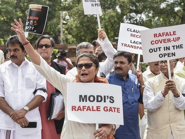 Opposition parties leaders raise slogans during a protest against the Union government over Rafale deal issue, at Parliament House in New Delhi on Friday