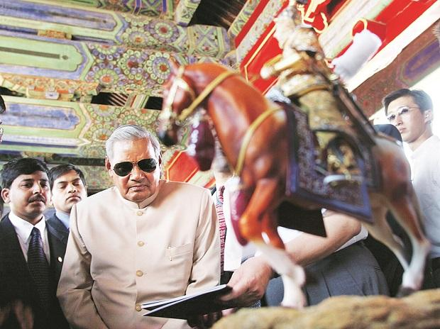 Atal Bihari Vajpayee looks at a gift given to him by the Forbidden City in Beijing, China in 2003. Reuters: File Photo