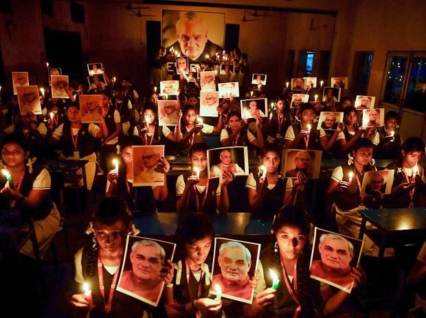 Students participate in a candlelight vigil to pay tribute to former prime minister Atal Bihari Vajpayee, in Chennai on Thursday