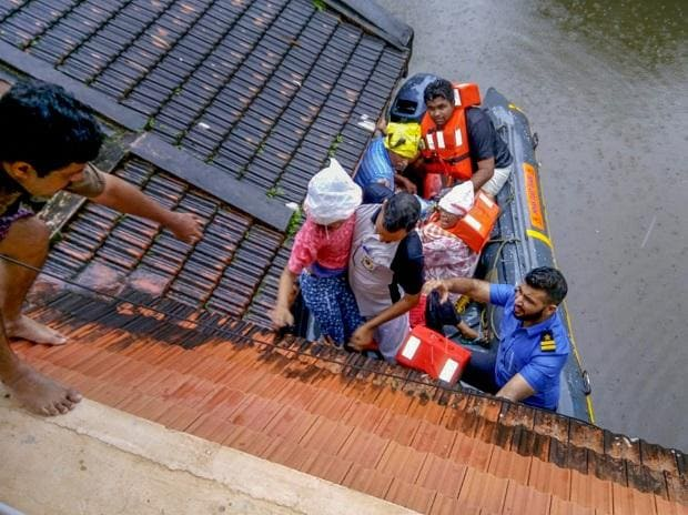Rescue teams evacuate people from flood affected areas, to relief camps at Kottayam district in Kerala, on Monday, Aug. 20, 2018.