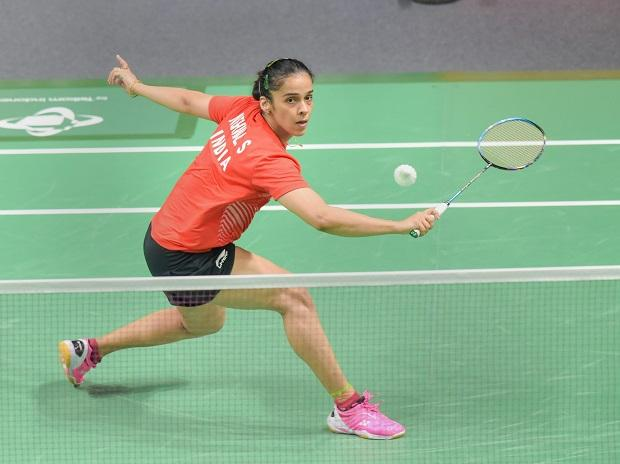 Saina Nehwal plays a shot against Tai Tzu Ying of Chinese Taipei during their women's singles semifinal match at the 18th Asian Games. Photo: PTI